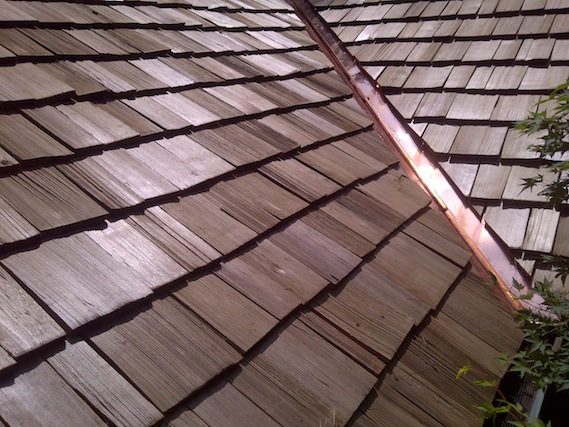 Cedar shake roof and copper work.