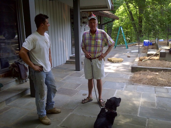 Kyle discussing new cedar shake roof with client John Rice.
